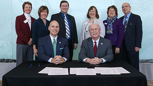 """HACC President John J. """"Ski"""" Sygielski, front left, and Shippensburg President Jody Harpster, pose for a photo after signing an agreement will allow HACC students at Shippensburg to earn their associate degree while attending SU. Also pictured in the back row, from left, Dr. Kathleen T. Doherty, Shannon S. Harvey, Dr. Rob Steinmetz, Dr. Cynthia A. Doherty, Dr. Tracy Schoolcraft and Dr. Rick Ruth."""