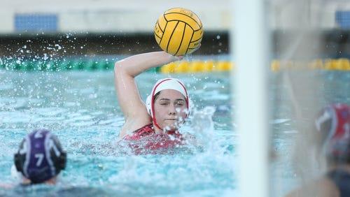 Shadow Hills High School's girls varsity water polo girls' team, in dark cap, hosted Palm Springs High School on January 17, 2017.