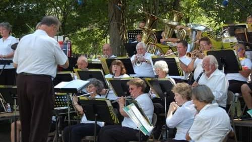 America's Hometown Band performs in a past outdoor concert.
