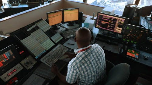 Air traffic controller Emil Watson uses data communications to  communicate with pilots, part of the Federal Aviation Administration's Next Generation Air Transportation system in the control tower at Miami International Airport on March 6, 2017 in Miami, Fla.