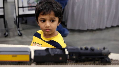Reyansh Agarwal, 4, of Oak Creek, operates a train during Trainfest, considered America's largest operating model Operating Railroad show, at Wisconsin State Fair Park.