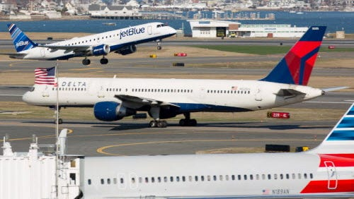 JetBlue, Delta and American airlines planes at Boston's Logan International Airport on April 13, 2015.