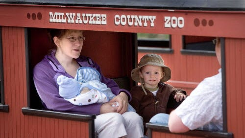 Lisa Prechel, of Pewaukee, takes her family on a train ride at the Milwaukee County Zoo.