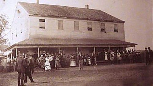 A historical photo of the Farmington Quaker Meetinghouse.