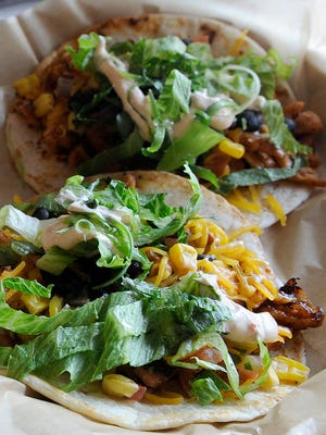 Barbecue chicken tacos with cheese sauce from Barrel and Boar in Downtown Newark.