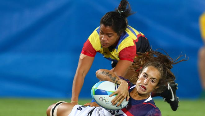 Aug 6, 2016; Rio de Janeiro, Brazil; USA back Ryan Carlyle (11) puts the ball down for a try as Colombia back Maria Camila Lopera Valle (9) falls to the ground during a rugby sevens match between the USA and Colombia at Deodoro Stadium in the Rio 2016 Summer Olympic Games.