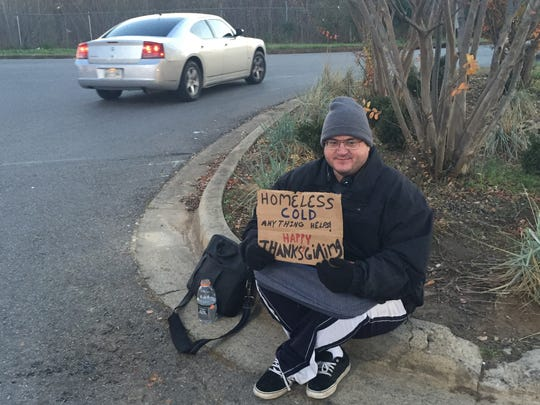 Sean Knutson, 44, of Lincoln, Neb., sits outside the