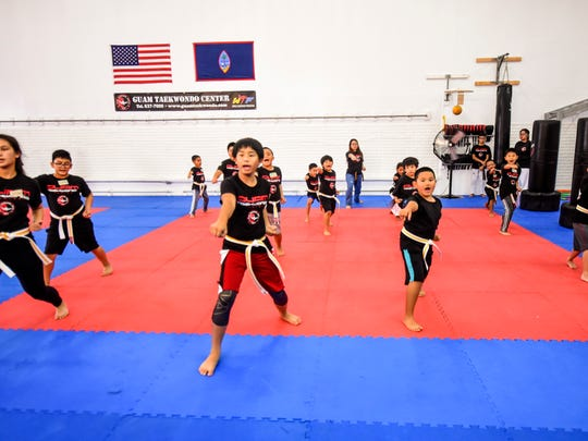 Young aspiring martial artists practice the self-defense art of taekwondo, taught by Master Noly Caluag, during a summer camp session at the Guam Taekwondo Center in Harmon on Wednesday, June 27, 2018.