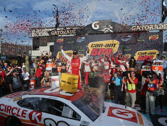 Matt Kenseth celebrates his Can-Am 500 win on Sunday at Phoenix Raceway in Avondale.