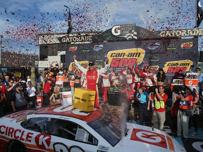 Matt Kenseth celebrates his win of the Can-Am 500 on