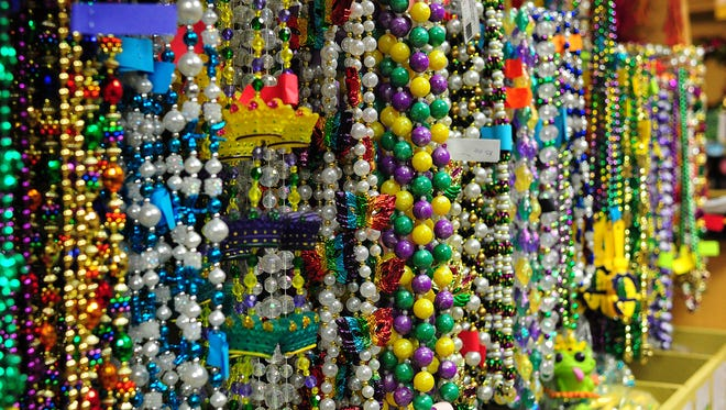 Multiple varieties of Mardi Gras beads are displayed on the walls of Beads Galore in Lafayette, LA, February 5, 2014.   By Paul Kieu, The Advertiser February 5, 2014