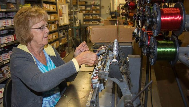 Sandy West operates a coil winding machine that makes output transformers for Macintosh amplifiers.