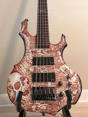 Jason Fresta's bass has been painted with human blood.
