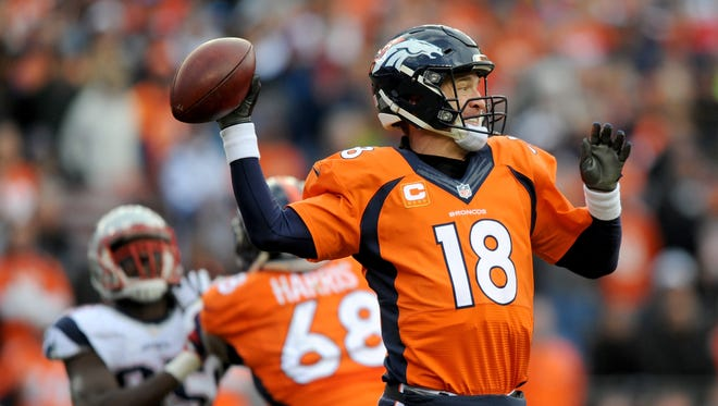 The Broncos' Peyton Manning fires downfield against the Patriots on Sunday.