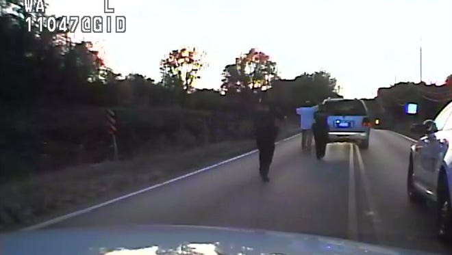 In this image made from a Friday, Sept. 16, 2016 police video, Terence Crutcher, center, is pursued by police officers as he walk to an SUV in Tulsa, Okla. Crutcher was taken to the hospital where he was pronounced dead after he was shot by the officer around 8 p.m., Friday, police said. Crutcher had no weapon on him or in his SUV, Tulsa Police Chief Chuck Jordan said Monday, Sept. 19, 2016.