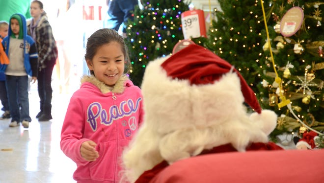 Visits with Santa bring smiles to children during the annual Shop With a Cop event slated for 8 a.m. Saturday, Dec. 10, at the Walmart Supercenter, 1021 E. Pine St. Santa is expected to arrive in a Deming Fire Department ladder truck escorted by members of the various law enforcement agencies in Deming and Luna County.