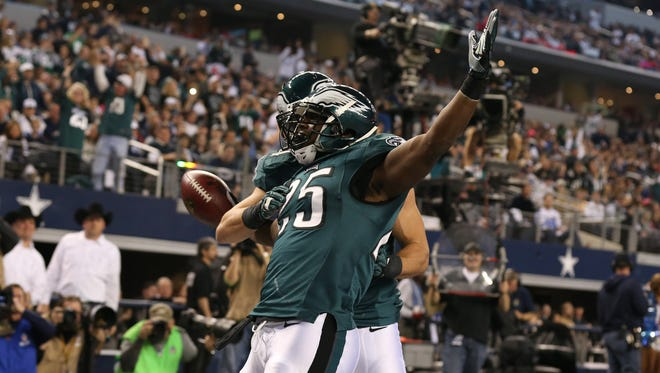 Philadelphia Eagles running back LeSean McCoy (25) celebrates his second quarter touchdown with receiver Riley Cooper (14) against the Dallas Cowboys at AT&T Stadium.