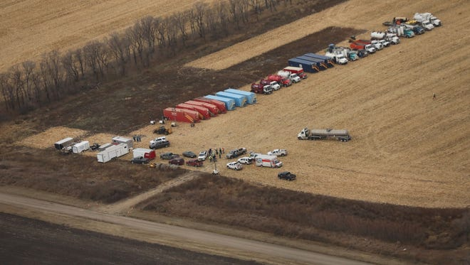TransCanada workers are shown preparing to clean up the spill from the Keystone pipeline in northern South Dakota.
