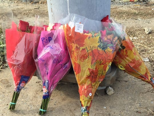 Friends left flowers at a makeshift memorial on Sunday.