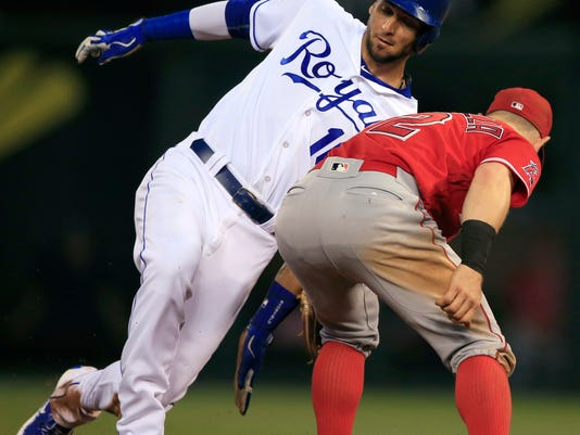 Kansas City Royals' Paulo Orlando (16) beats the tag of Los Angeles Angels second baseman Johnny Giavotella (12) during the fifth inning of a baseball game at Kauffman Stadium in Kansas City, Mo., Tuesday, July 26, 2016. Orlando was safe at second base with a stolen base on the play. (AP Photo/Orlin Wagner)