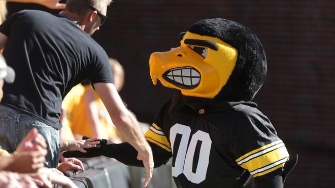 Herky meets with fans during the Ball State game on Saturday, Sept. 6, 2014, at Kinnick Stadium in Iowa City, Iowa.