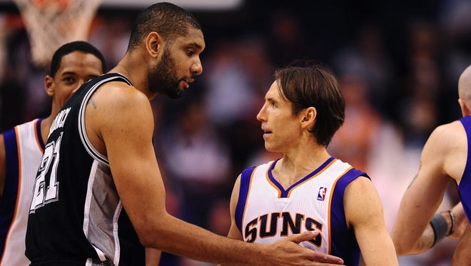 Phoenix Suns guard Steve Nash (right) greets San Antonio Spurs forward Tim Duncan prior to a game in 2012. The Spurs defeated the Suns 107-100.