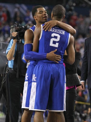 Kentucky's Andrew Harrison hugs his brother Aaron Harrison after Aaron made a three-point shot with five seconds remaining in the second half to give the Wildcats a one-point victory over Wisconsin Saturday night at the Final Four at AT&T Stadium in Arlington, Texas. April 5, 2014 By Matt Stone, The C-J
