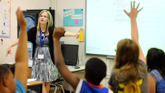 A fifth-grade class learns an English language arts lesson in Middletown, Del., last October.