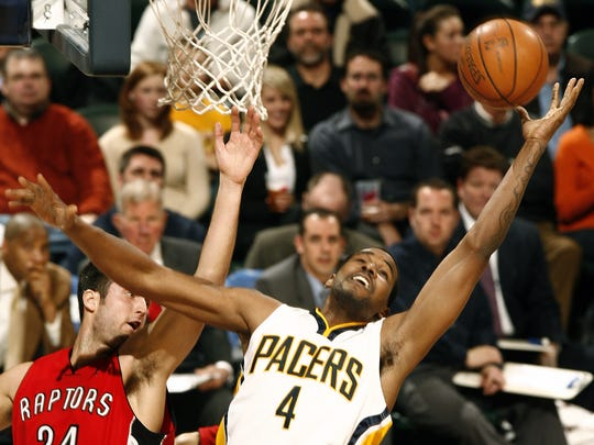 The Pacers' Shawne Williams grabs this rebound in first half action. The Indiana Pacers host the Toronto Raptors at Conseco Fieldhouse in Indianapolis, IN on Monday, Feb 25, 2008. The Pacers lost 102-98. (Sam Riche / The Indianapolis Star)
