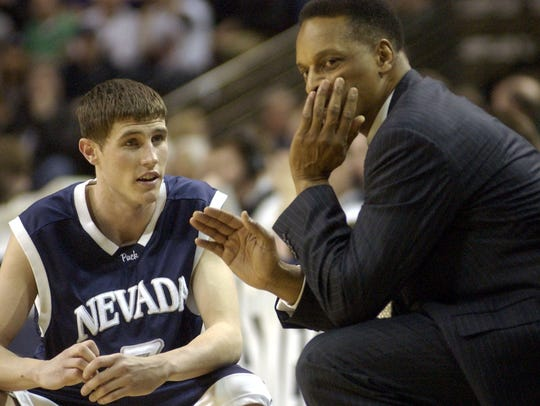 Former Wolf Pack coach Trent Johnson, right, talks to Todd Okeson, a current Nevada assistant, in the final moments of Nevada's 2004 NCAA Tournament win over Michigan State.