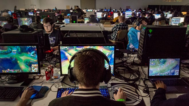 Mat Smith competes on December 4, 2016, during the KC Game On event at the KCI Expo Center in Kansas City, Mo. Smith is captain of Team KC, an amateur competitive video gaming group. The team is learning how to exercise for their sport with performance coach Jake Middleton.