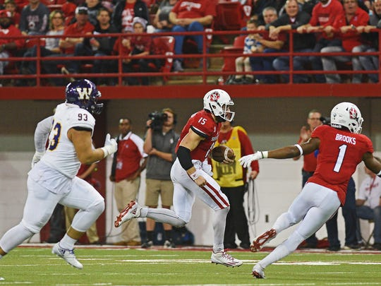 USD quarterback Chris Streveler (15) carries the ball during a game against Western Illinois Saturday, Oct. 29, 2016, at the DakotaDome on the University of South Dakota campus in Vermillion, S.D.