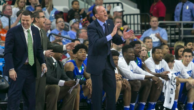 Joe Dooley and his assistants react during their game against UNC in the NCAA tournament on Thursday, March 17, 2016 in Raleigh, NC.