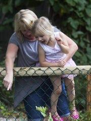 Brenda Blank holds her granddaughter, Zoe McDaniel,