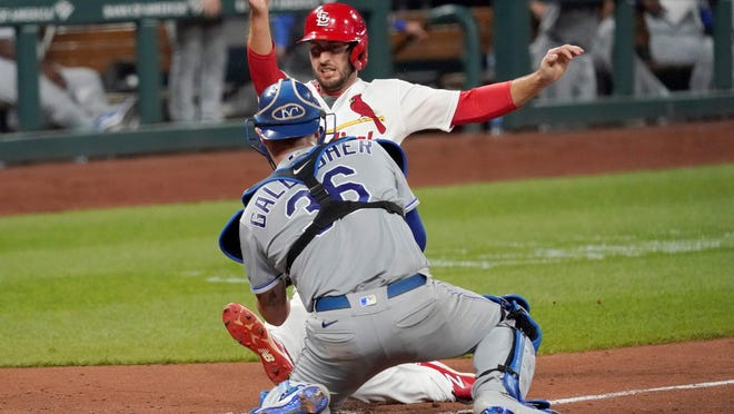St. Louis Cardinals base runner Paul DeJong is tagged out at home by Kansas City Royals catcher Cam Gallagher (36) while attempting to score the tying run Tuesday night in St. Louis.