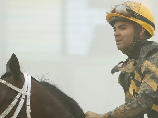 Luis Saez aboard Bravazo returns to the paddock after the 143rd running of the Preakness Stakes at Pimlico Race Course.
