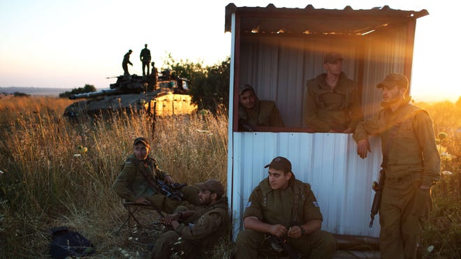 Israeli soldiers are seen near the Quneitra border crossing with Syria in the Israeli-annexed Golan Heights on Sunday.