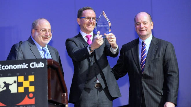 Detroit News Publisher Jonathan Wolman, left, Wolfgang Bauer from BMW and Editorial Page Editor Nolan Finley.