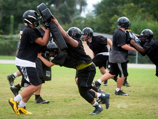 New and returning football players at Milton High School return to camp in preparation for the Panther's 2016 season.