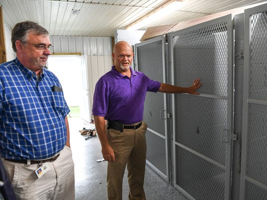 Michael Hayes, left, Pickens County Risk Manager, looks at a holding area under construction with Robert Kelley, right, Director for Adoption of Animals Facility, at the Pickens County Animal Control Department in Pickens on Friday.