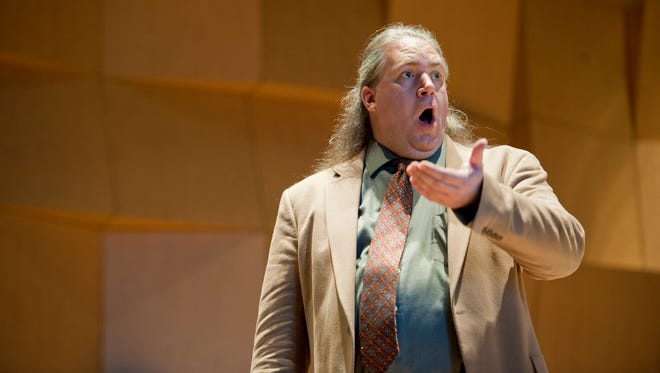 Boston opera singer Wesley Ray Thomas, who has struggled with mental illness, rehearses with Me2/Orchestra at the University of Vermont Recital Hall in advance of their Saturday performance.