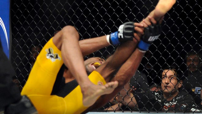Anderson Silva, of Brazil screams, after kicking Chris Weidman ,of Baldwin, N.Y., and injuring his leg during the UFC 168 mixed martial arts middleweight championship bout on Saturday, Dec. 28, 2013, in Las Vegas. Weidman won during the second round by a technical knock out after the kick by Silva.