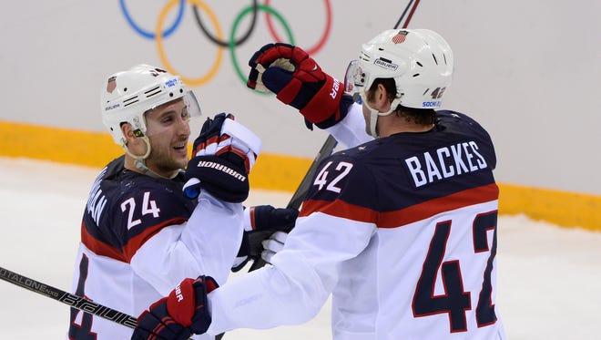 Greece native Ryan Callahan, left, congratulates David Backes after Backes' goal in Wednesday's win over the Czech Republic in Sochi, Russia.