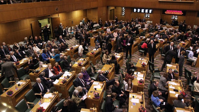 Legislators and dignitaries gather for the joint opening session of the 2013 Oregon Legislature Jan. 14, 2013.