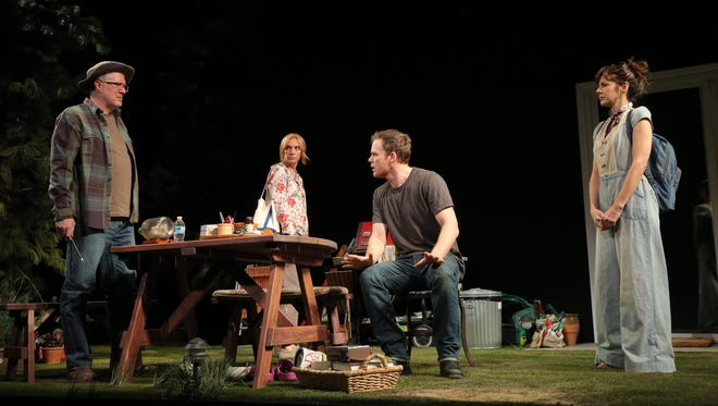 Tracy Letts, Toni Collette, Michael C. Hall and Marisa Tomei perform during a scene from 'The Realistic Joneses' at the Lyceum Theatre in New York.