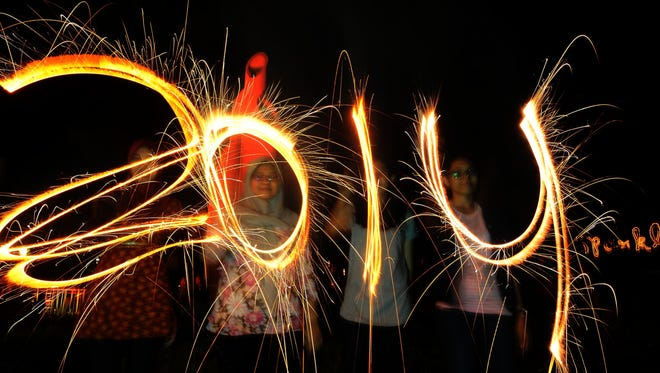 Indonesians set up fireworks to celebrate New Years on Dec. 31, 2013 in Surabaya, Indonesia.