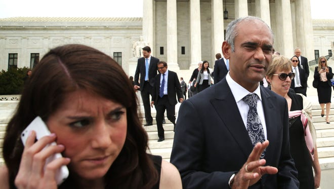Aereo CEO and founder Chet Kanojia leaves the Supreme Court after oral arguments in April.