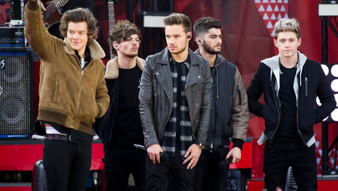 "One Direction members  Harry Styles, left, Louis Tomlinson, Liam Payne, Zayn Malik and Niall Horan perform on ABC's ""Good Morning America"" on Tuesday  in New York."