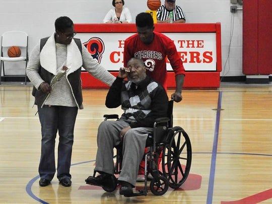 Joshua Clanton escorts his dad, John, and his mom,