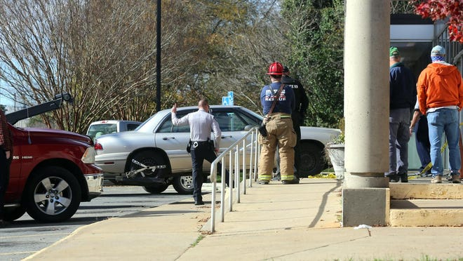 A car is removed from the front door at the Kings Mountain Post Office on Tuesday.